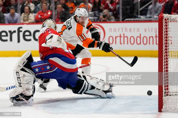 Travis Konecny of the Philadelphia Flyers scores a goal against Braden Holtby of the Washington Capitals in the second period at Capital One Arena on...