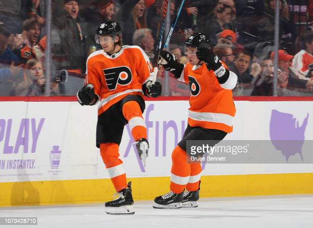 Travis Konecny of the Philadelphia Flyers scores at 423 of the first period against the Ottawa Senators and is joined by Ivan Provorov at the Wells...