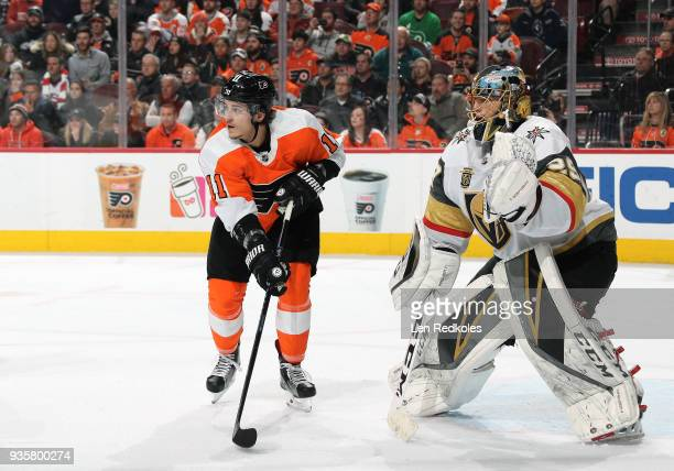 Travis Konecny of the Philadelphia Flyers sets up in the crease against MarcAndry Fleury of the Vegas Golden Knights on March 12 2018 at the Wells...