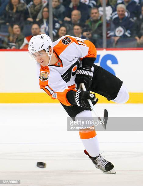 Travis Konecny of the Philadelphia Flyers shoots the puck down the ice during first period action against the Winnipeg Jets at the MTS Centre on...