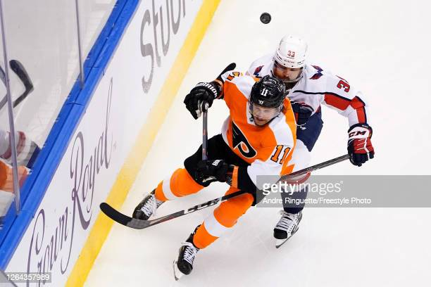 Travis Konecny of the Philadelphia Flyers skates against Radko Gudas of the Washington Capitals during the first period in the Eastern Conference...