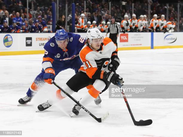 Travis Konecny of the Philadelphia Flyers skates against the New York Islanders at NYCB Live's Nassau Coliseum on March 09 2019 in Uniondale New York...