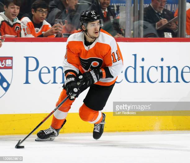 Travis Konecny of the Philadelphia Flyers skates the puck against the San Jose Sharks on February 25, 2020 at the Wells Fargo Center in Philadelphia,...