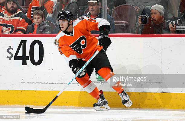 Travis Konecny of the Philadelphia Flyers skates the puck against the Nashville Predators on December 19 2016 at the Wells Fargo Center in...