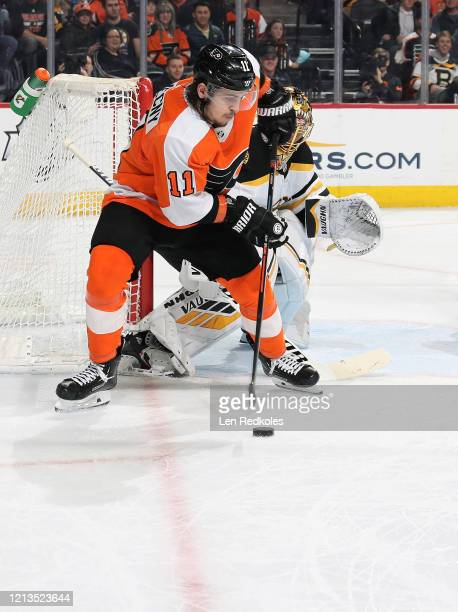 Travis Konecny of the Philadelphia Flyers skates the puck in for a shot on goal against Tuukka Rask of the Boston Bruins on March 10 2020 at the...