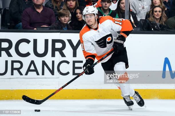 Travis Konecny of the Philadelphia Flyers skates with the puck during the second period against the Los Angeles Kings at STAPLES Center on December...