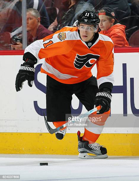 Travis Konecny of the Philadelphia Flyers skates with the puck against the Winnipeg Jets on November 17 2016 at the Wells Fargo Center in...