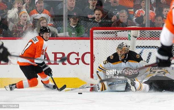 Travis Konecny of the Philadelphia Flyers takes a shot on goal against Anton Khudobin of the Boston Bruins on April 1 2018 at the Wells Fargo Center...