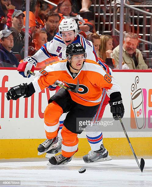 Travis Konecny of the Philadelphia Flyers takes the puck as Ryan Graves defends on April 7 2015 at the Wells Fargo Center in Philadelphia Pennsylvania