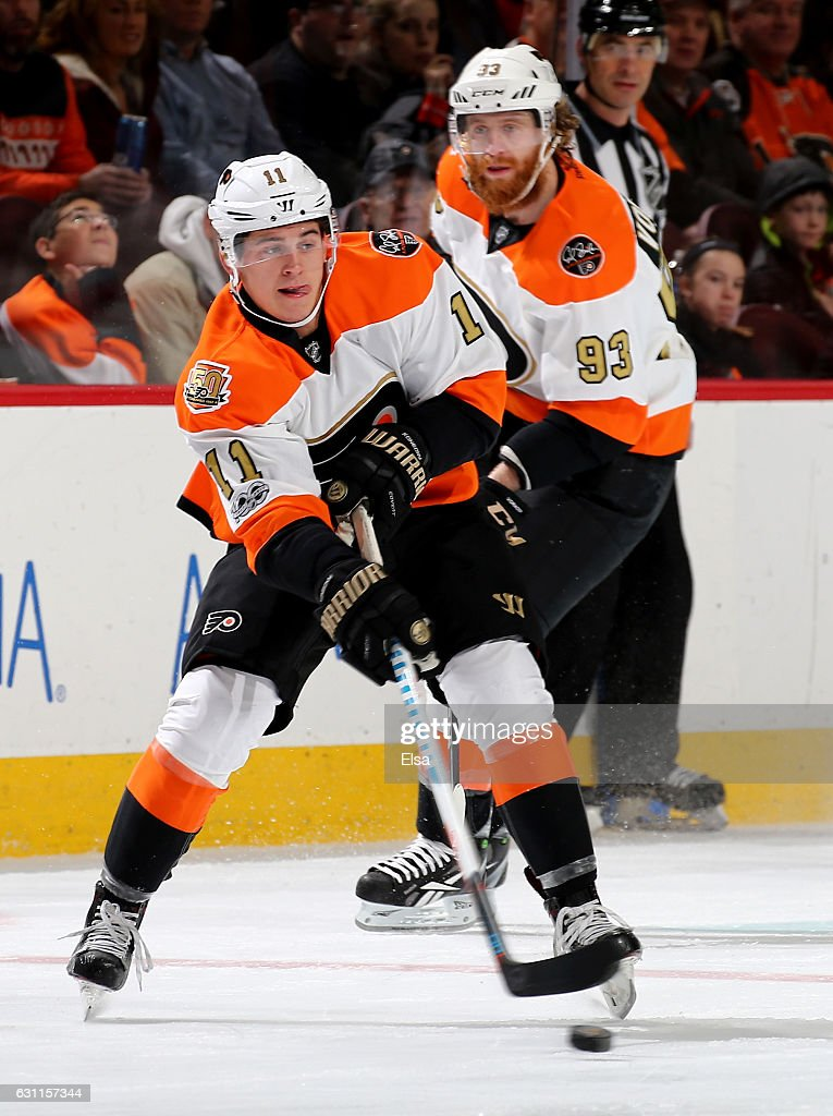 Travis Konecny #11 of the Philadelphia Flyers takes the puck as teammate Jakub Voracek #93 skates by in the second period against the Tampa Bay Lightning on January 7, 2017 at Wells Fargo Center in Philadelphia, Pennsylvania.