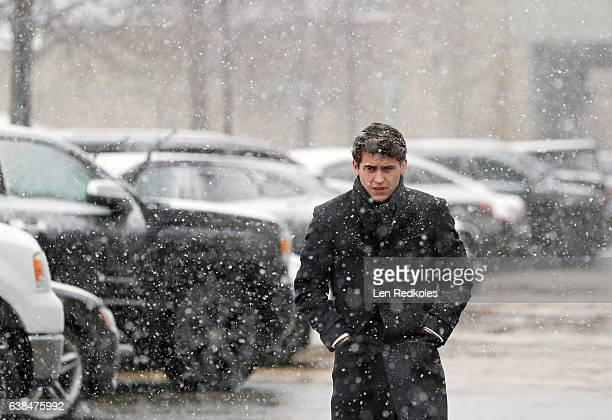 Travis Konecny of the Philadelphia Flyers walks through the parking lot during a snowstorm several hours before his game against the Tampa Bay...