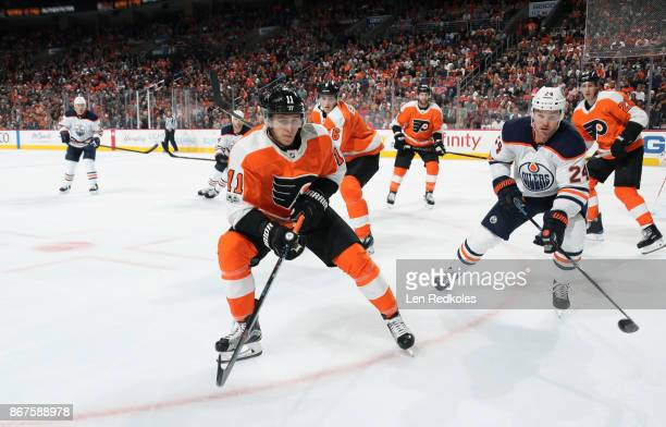 Travis Konecny Travis Sanheim Andrew MacDonald and Dale Weise of the Philadelphia Flyers in action against Brad Malone of the Edmonton Oilers on...