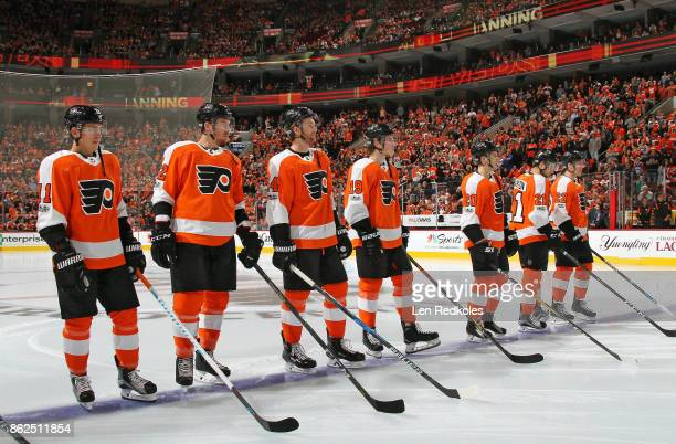 Travis Koneny Michael Raffl Sean Couturier Nolan Patrick Taylor Leier Scott Laughton and Dale Weise of the Philadelphia Flyers stand on the blue line...