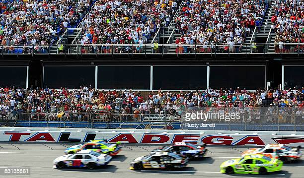 Travis Kvapil, driver of the Academy Sports & Outdoors Ford leads the field to the green flag to start the NASCAR Sprint Cup Series Amp Energy 500 at...