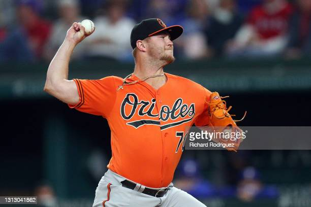 Travis Lakins Sr. #70 of the Baltimore Orioles pitches against the Texas Rangers in the seventh inning during the MLB game at Globe Life Field on...