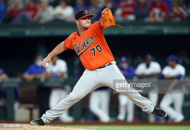 Travis Lakins Sr. #70 of the Baltimore Orioles pitches in the seventh inning against the Texas Rangers during the MLB game at Globe Life Field on...