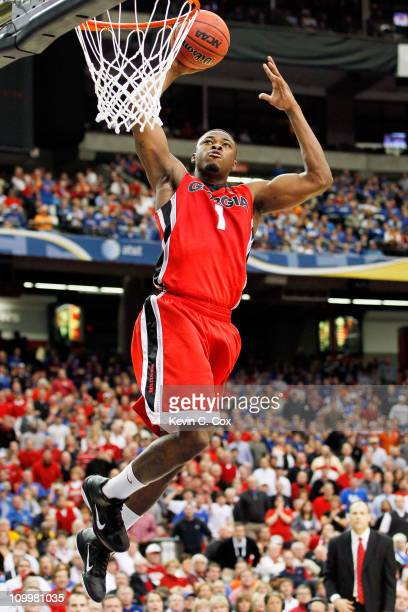 Travis Leslie of the Georgia Bulldogs dunks on the Alabama Crimson Tide during the quarterfinals of the SEC Men's Basketball Tournament at Georgia...
