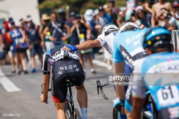 Travis McCabe of the United States and the UnitedHealthcare Pro Cycling Team congratulates Jasper Philipsen of Belgium and the Hagens Berman Axeon...