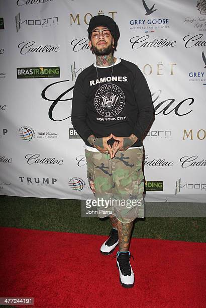Travis McCoy attends the Carolina Herrera Fashion Show with GREY GOOSE Vodka at the Cadillac Championship at Trump National Doral on March 7 2014 in...
