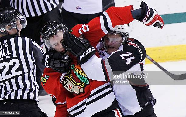 Travis McEvoy of the Vancouver Giants grabs Dominic Turgeon of the Portland Winterhawks during the first period of their WHL game at the Pacific...