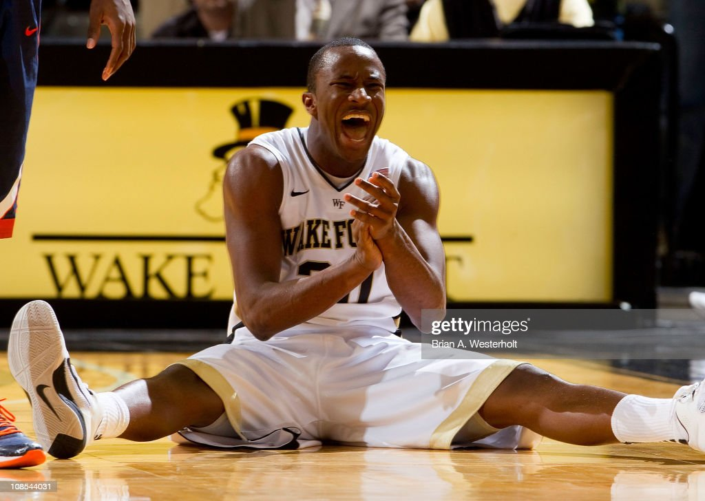 Travis McKie #30 of the Wake Forest Demon Deacons reacts after having caused a jump ball during second half action against the Virginia Cavaliers at the Lawrence Joel Coliseum on January 29, 2011 in Winston Salem, North Carolina. The Demon Deacons defeated the Cavaliers 76-71.