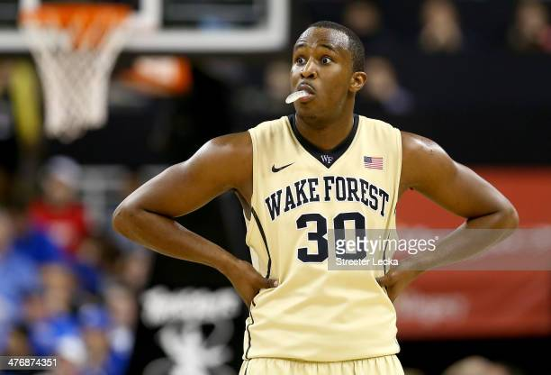 Travis McKie of the Wake Forest Demon Deacons reacts during their game against the Duke Blue Devils at Joel Coliseum on March 5, 2014 in...
