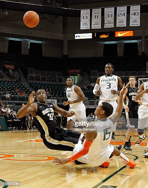 Travis McKie of the Wake Forest Demon Deacons throws up a shot over Rion Brown of the Miami Hurricanes during a game at the BankUnited Center on...