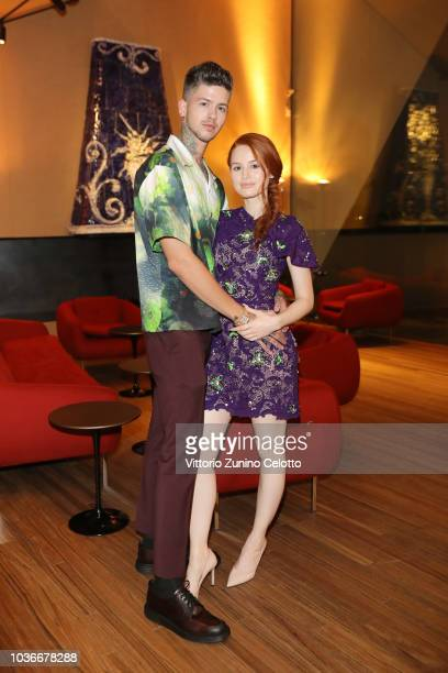 Travis Mills and Madelaine Petsch attend Prada Spring/Summer 2019 Womenswear Fashion Show on September 20 2018 in Milan Italy
