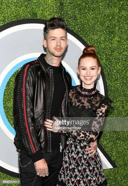 Travis Mills and Madelaine Petsch attend the 2017 GQ Men of the Year party at Chateau Marmont on December 7 2017 in Los Angeles California