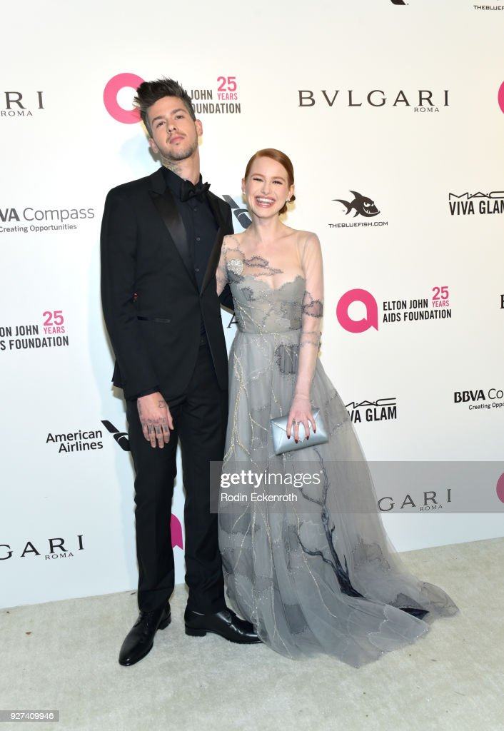 Travis Mills and Madelaine Petsch attend the 26th annual Elton John AIDS Foundation's Academy Awards Viewing Party at The City of West Hollywood Park on March 4, 2018 in West Hollywood, California.