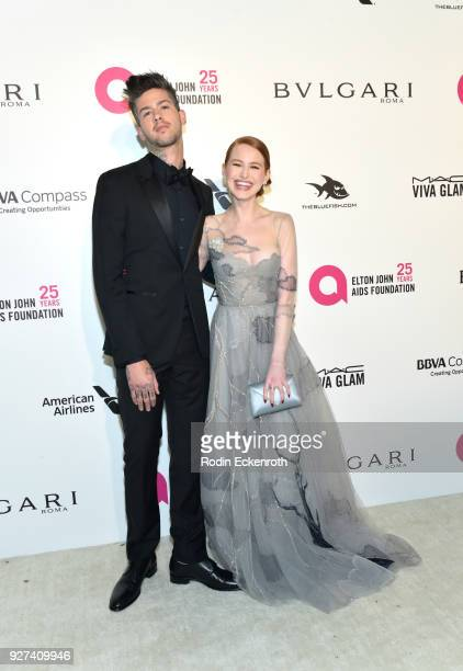 Travis Mills and Madelaine Petsch attend the 26th annual Elton John AIDS Foundation's Academy Awards Viewing Party at The City of West Hollywood Park...