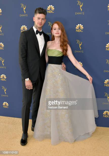 Travis Mills and Madelaine Petsch attend the 70th Emmy Awards at Microsoft Theater on September 17 2018 in Los Angeles California