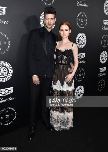 Travis Mills and Madelaine Petsch attend The Art Of Elysium's 11th Annual Celebration on January 6 2018 in Santa Monica California