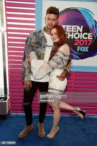 Travis Mills and Madelaine Petsch attend the Teen Choice Awards 2017 at Galen Center on August 13 2017 in Los Angeles California