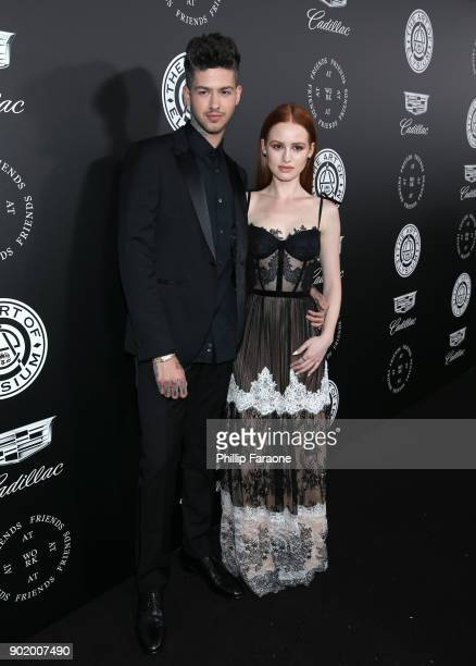 Travis Mills and Madelaine Petsch attends The Art Of Elysium's 11th Annual Celebration on January 6 2018 in Santa Monica California