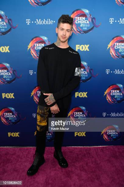 Travis Mills attends FOX's Teen Choice Awards at The Forum on August 12 2018 in Inglewood California