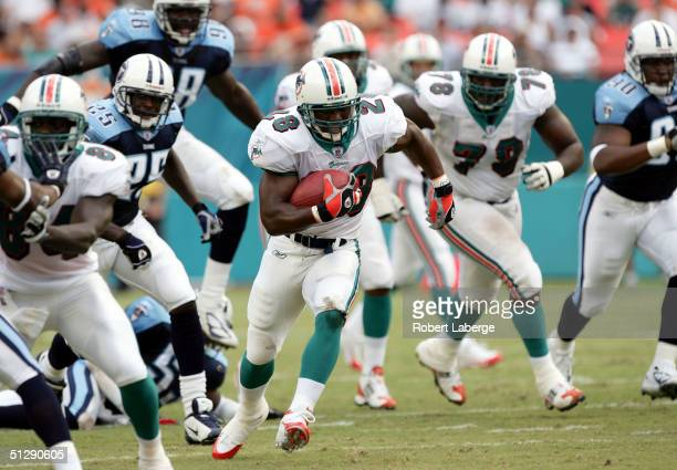Travis Minor of the Miami Dolphins runs with the ball in the first half of the game against the Tennessee Titans won by the Titans 177 at Pro Player...
