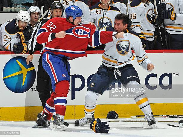 Travis Moen of the Montreal Canadiens and Cody McCormick of the Buffalo Sabres exchange punches during the NHL game on November 27 2010 at the Bell...