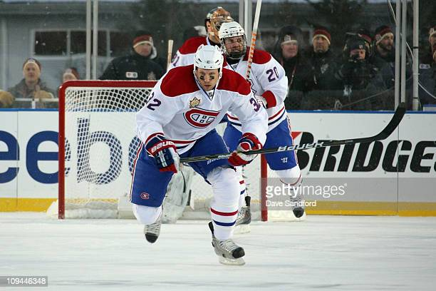 Travis Moen of the Montreal Canadiens skates against the Calgary Flames during the 2011 NHL Tim Hortons Heritage Classic at McMahon Stadium on...