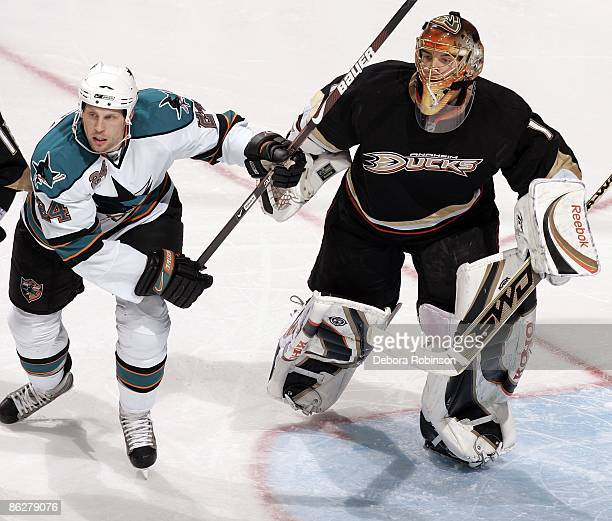 Travis Moen of the San Jose Sharks defends outside the crease against Jonas Hiller of the Anaheim Ducks during Game Six of the Western Conference...