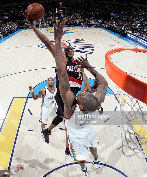 Travis Outlaw of the Portland Trail Blazers goes to the basket against Joe Smith of the Oklahoma City Thunder at the Ford Center on February 6 2009...