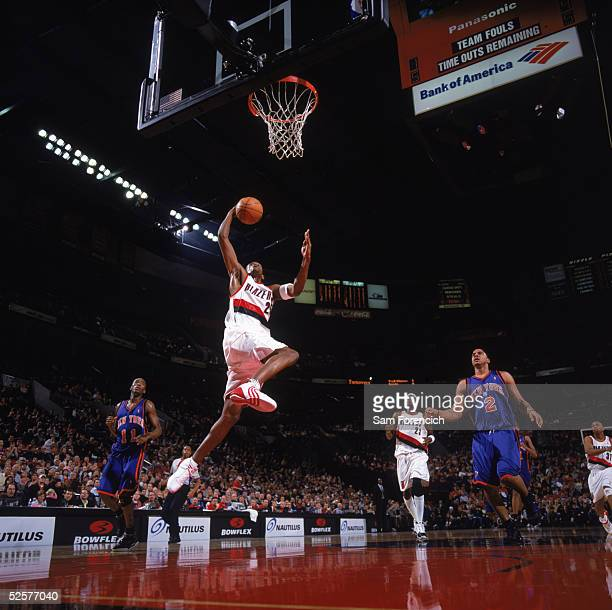 Travis Outlaw of the Portland Trail Blazers takes the ball to the basket during a game against the New York Knicks at The Rose Garden on March 26,...