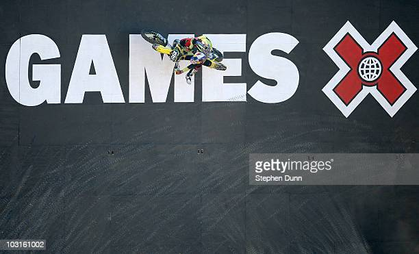 Travis Pastrana climbs up a wall during the Moto X Freestyle Round One at the Los Angeles Coliseum during X Games 16 on July 29 2010 in Los Angeles...