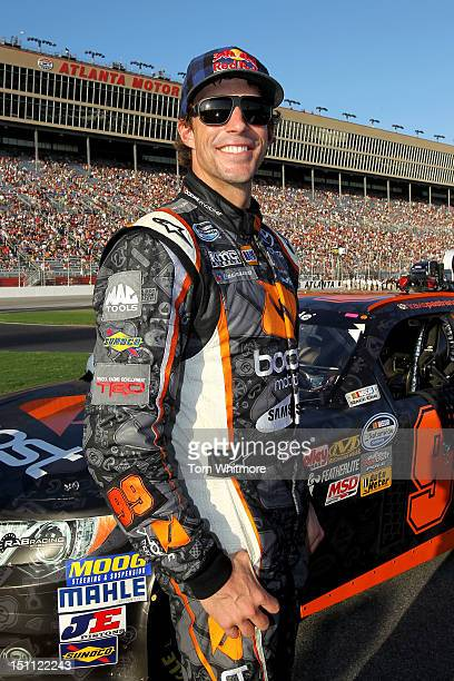 Travis Pastrana driver of the Boost Mobile Toyota smiles on the grid prior to the start of the NASCAR Nationwide Series NRA American Warrior 300 at...