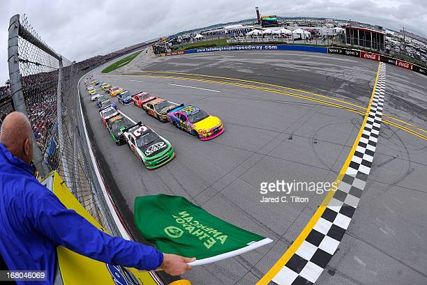 Travis Pastrana driver of the Roush Fenway Racing Ford and Austin Dillon driver of the AdvoCare Chevrolet lead the start of the NASCAR Nationwide...