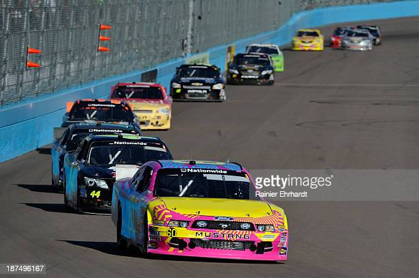 Travis Pastrana driver of the Roush Fenway Racing Ford leads a pack of cars during the NASCAR Nationwide Series ServiceMaster 200 at Phoenix...