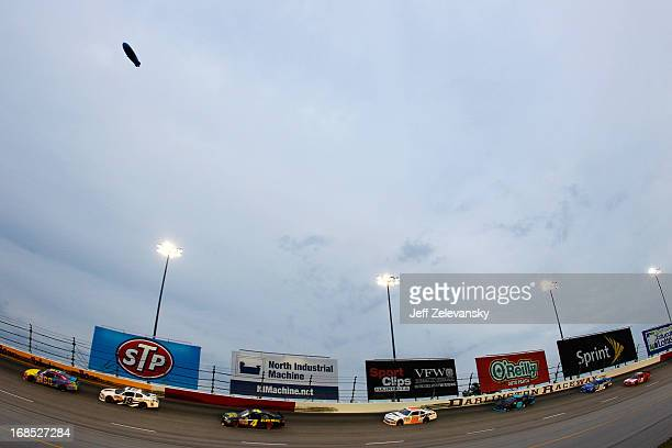 Travis Pastrana driver of the Roush Fenway Racing Ford leads cars down the backstretch during the NASCAR Nationwide Series VFW Sport Clips Help A...