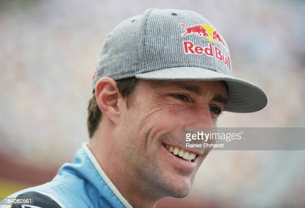 Travis Pastrana driver of the Roush Fenway Racing Ford looks on from the grid during qualifying for the NASCAR Nationwide Series Dollar General 300...