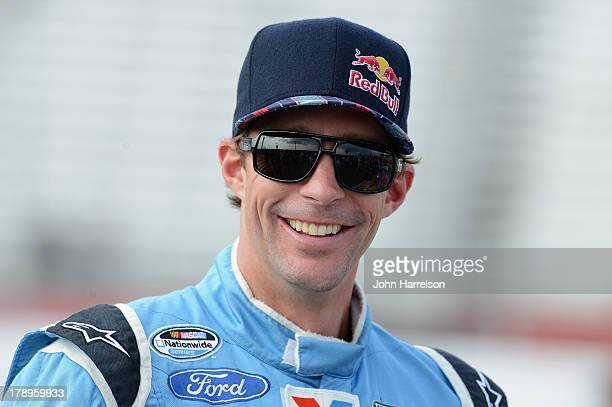 Travis Pastrana driver of the Roush Fenway Racing Ford stands on the grid during qualifying for the NASCAR Nationwide Series Great Clips/Grit Chips...