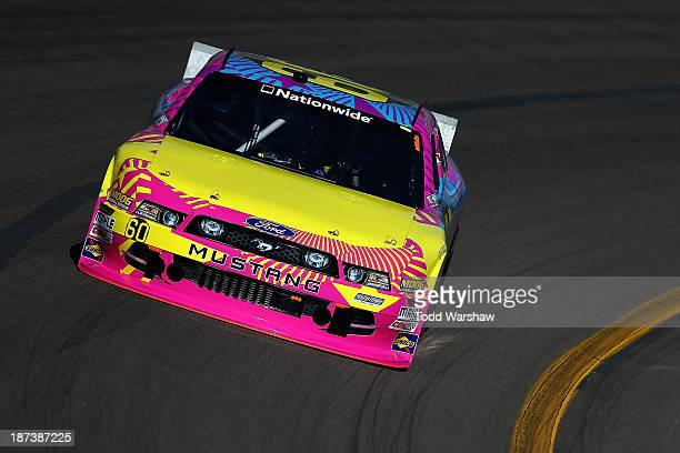Travis Pastrana drives the Roush Fenway Racing Ford during practice for the NASCAR Nationwide Series ServiceMaster 200 at Phoenix International...